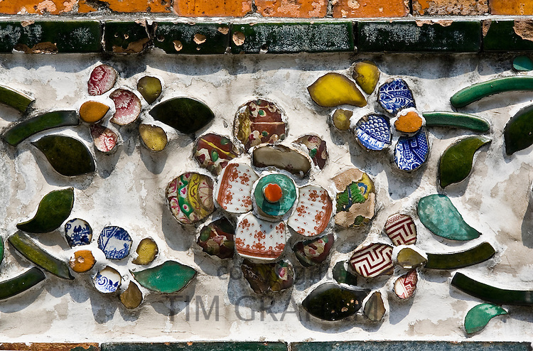 Ceramic tiles decorating the walls of Wat Arun,Temple of the Dawn, Bangkok, Thailand