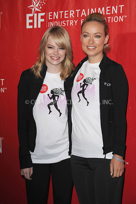 WWW.ACEPIXS.COM . . . . . .May 5, 2012...New York City....Emma Stone and Olivia Wilde at the 15th Annual EIF Revlon Run/Walk For Women in Times Square on May 5, 2012 in New York City on May 5, 2012  in New York City ....Please byline: KRISTIN CALLAHAN - ACEPIXS.COM.. . . . . . ..Ace Pictures, Inc: ..tel: (212) 243 8787 or (646) 769 0430..e-mail: info@acepixs.com..web: http://www.acepixs.com .