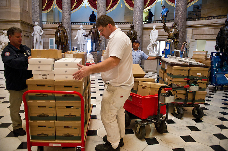 WASHINGTON, DC- Dec. 21: General Supervisor for the U.S. Capitol Superintendent's Office Billy Bennett, in blue jacket, and Jerry Seiss, masonry assistant supervisor, move boxes from House Minority Leader Eric Cantor's office to an office space above Statuary Hall. Cantor is the incoming House Majority Leader for the 112th Congress. (Photo by Scott J. Ferrell/Congressional Quarterly)