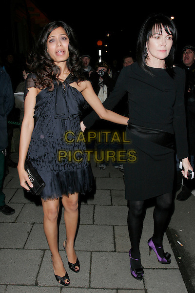 FREIDA PINTO.The Finch & Partners' Chanel Pre-BAFTA Party held at Annabel's, London, England..February 7th, 2009.full length blue black dress clutch bag sheer chiffon ribbon peep toe shoes mouth open funny face.CAP/AH.©Adam Houghton/Capital Pictures.
