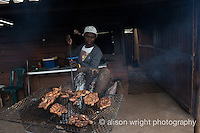 Africa, Swaziland, Malkerns. Selling BBQ chicken in the local Manzini market.