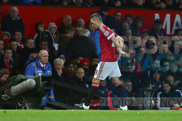 Morgan Schneiderlin of Manchester United goes off holding his lower back - Manchester United vs West Ham United - Barclay's Premier League - Old Trafford - Manchester - 05/12/2015 Pic Philip Oldham/SportImage