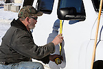 Activists Ken Medenbeck of Cresent, Oregon, measures a spot to change signage on government vehicles at the Malheur National Wildlife Reserve on January 15, 2016 in Burns, Oregon.  Ammon Bundy and about 20 other protesters took over the refuge on Jan. 2 after a rally to support the imprisoned local ranchers Dwight Hammond Jr., and his son, Steven Hammond.  ©2016. Jim Bryant Photo. All Rights Reserved.