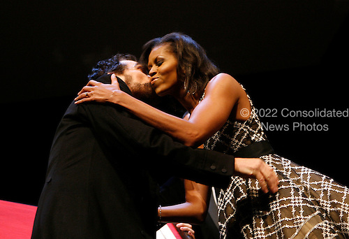 Washington, DC - February 11, 2009 -- First lady Michelle Obama kisses an actor greets dressed as Abraham Lincoln during the Ford's Theater reopening celebration, Washington, DC, Wednesday, February 11, 2009. Abraham Lincoln was shot at the Ford Theater in the evening of April 14,1865. The theater underwent an 18 month renovation..Credit: Aude Guerrucci - Pool via CNP