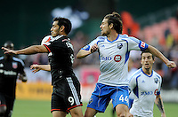 Washington D.C. - May 17, 2014: Fabian Espindola (9) of D.C. United goes against Heath Pearce (44) of Montreal Impact.  D.C. United tied the Montreal Impact 1-1 during a Major League Soccer match for the 2014 season at RFK Stadium.