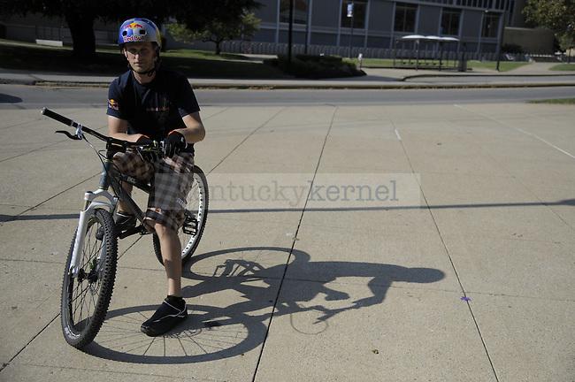 World record holder biker Thomas Oehler biking around UK's campus putting on a show. Photo by Mike Weaver   Staff