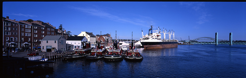 Tugs and freighters on the waterfront at Portsmouth, New Hampshire. Photograph by Peter E. Randall