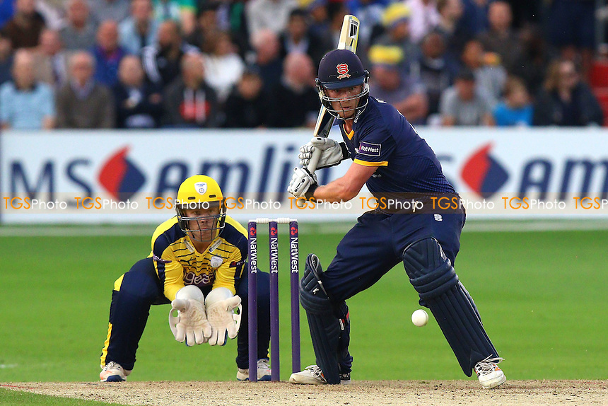 Tom Westley in batting action for Essex as Lewis McManus looks on from behind the stumps during Essex Eagles vs Hampshire, Nat West T20 Blast Cricket at the Essex County Ground on 24th June 2016