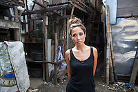 UK celebrity Myleene Klass poses for a portrait in an urban slum in Paranaque City, Metro Manila, The Philippines on 18 January 2013. Photo by Suzanne Lee for Save the Children UK