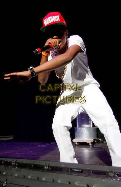 Young Marqus.Teen hip-hop sensation Young Marqus performed as part of the #1 Girl Tour with Mindless Behavior at the Fox Theater in downtown Atlanta, Atlanta, GA, USA, August 4th, 2012..music live on stage concert gig full length white t-shirt trousers red cap hat backwards trainers microphone singing 3/4 hand .CAP/ADM/DH.©Dan Harr/AdMedia/Capital Pictures.