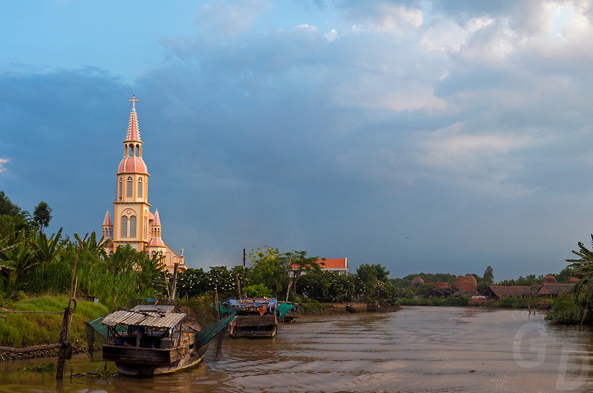 A church amongst the Brick production and Kiln of Vinh Long in the Mekong Delta, Vietnam.