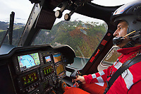 "Switzerland. Canton Grisons. Lai da Marmorera (Marmorera Stausee). The pilot Silvio Pini flies a Rega Agusta AW109 SP Grand ""Da Vinci"" helicopter on its way to the nearest suitable hospital. The Rega has rescued a swiss german hunter with an broken shoulder. All Rega helicopters carry a crew of three: a pilot, an emergency physician, and a paramedic who is also trained to assist the pilot for radio communication, navigation, terrain/object avoidance, and winch operations. The name Rega was created by combining letters from the name ""Swiss Air Rescue Guard"" as it was written in German (Schweizerische Rettungsflugwacht), French (Garde Aérienne Suisse de Sauvetage), and Italian (Guardia Aerea Svizzera di Soccorso). Rega is a private, non-profit air rescue service that provides emergency medical assistance in Switzerland. Rega mainly assists with mountain rescues, though it will also operate in other terrains when needed, most notably during life-threatening emergencies. As a non-profit foundation, Rega does not receive financial assistance from any government. The AgustaWestland AW109 is a lightweight, twin-engine, helicopter built by the Italian manufacturer Leonardo S.p.A. (formerly AgustaWestland, Leonardo-Finmeccanica and Finmeccanica). Leonardo S.p.A is an Italian global high-tech company and one of the key players in aerospace. In close collaboration with the manufacturer, the Da Vinci has been specially designed to cater for Rega's particular requirements as regards carrying out operations in the mountains. It optimally fulfills the high demands made of it in terms of flying characteristics, emergency medical equipment and maintenance. Safety, performance and space have been increased, and maintenance and noise emissions reduced. Lai da Marmorera is a reservoir in the Grisons (Graubunden) and is part of the Parc Ela nature park. 20.09.2017 © 2017 Didier Ruef"