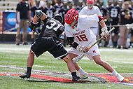 College Park, MD - May 14, 2017: Maryland Terrapins Austin Henningsen (18) tries to win the faceoff during the NCAA first round game between Bryant and Maryland at  Capital One Field at Maryland Stadium in College Park, MD.  (Photo by Elliott Brown/Media Images International)