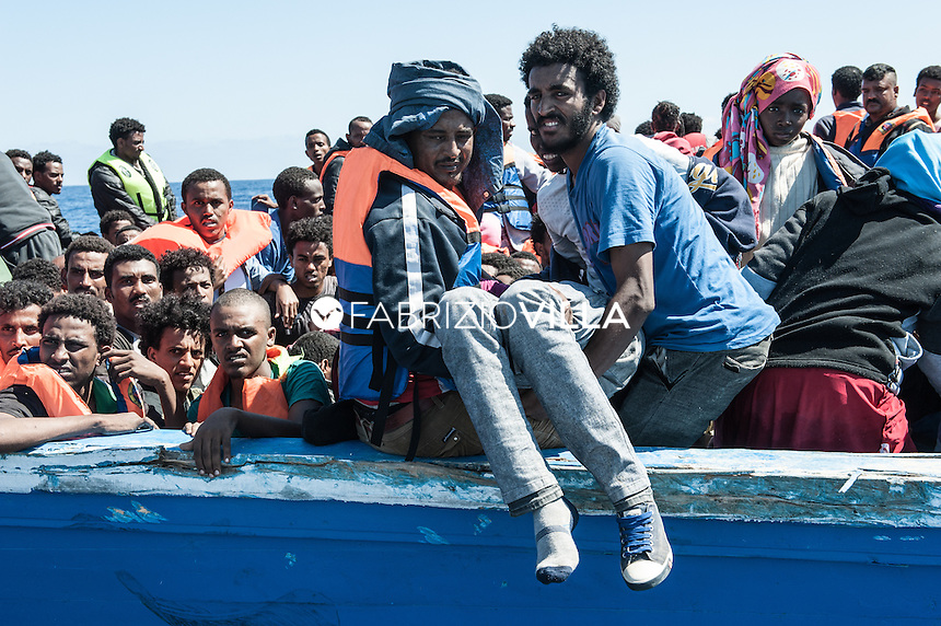 Strait of Sicily on May 29, 2015. The ship Spica Italian Navy, with a crew of only 60 men, 1 000 migrants rescued in international waters 30 miles from Libya. The refugees who were rescued, among them 200 children, women, men and the elderly, are from Eritrea and Syria.