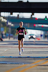 Images of the Start and Finish Line at the Quad Cities Marathon in 2010. This important sporting event is growing each year. These photographs show the intensity as well as the fun of this athletic event as seen here as Krista Vrombaut approaches the finish as a Winner at the Quad Cities Marathon 2010