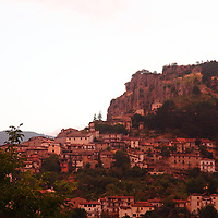 Here, a view of a part of the small town of Tagliacozzo, in the province of L&rsquo;Aquila, near the boundary between Lazio and Abruzzo, at the sunset light. The old buildings are literally clinged to the hillside, with the characteristic high rocks that stands above them. The image was taken before the recent strong earthquakes. This is an enlargement of the original photo.<br />