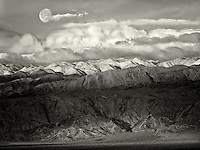 Panamint Mountains with moon and snow. Death Valley National Park, California