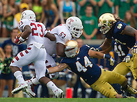 Linebacker Carlo Calabrese (44) attempts to tackle Temple Owls halfback Zaire Williams (23).