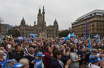 A crowd listening to entertainment at a pro-independence gathering in George Square, Glasgow. The gathering brought together Yes Scotland supporters who favour Scotland leaving the union with the United Kingdom. On the 18th of September 2014, the people of Scotland voted in a referendum to decide whether the country's union with England should continue or Scotland should become an independent nation once again and leave the United Kingdom.