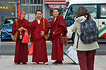 Hong Kong  Sair Kung, Hong Kong  A tourist photographs a trio of buddhist monks on the streets of Sai Kung.