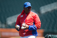 Cuban National Team assistant coach Jorge Ricardo Gallardo Figueroa (40) throws batting practice prior to the game against the US Collegiate National Team at BB&T BallPark on July 4, 2015 in Charlotte, North Carolina.  The United State Collegiate National Team defeated the Cuban National Team 11-1.  (Brian Westerholt/Four Seam Images)