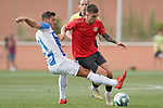 CD Leganes' Ruben Perez (r) and Rayo Vallecano's Joni Montiel during friendly match. July 13,2018. (ALTERPHOTOS/Acero)