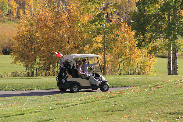 Women in golf cart at Vail Valley Golf Course, Colorado.