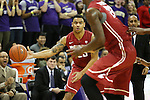 Washington State guard, DaVonte Lacy, passes to a teammate during the Cougars Pac-12 Conference tilt with arch-rival Washington at Alaska Airlines Arena in Seattle, Washington, on February 28, 2014.