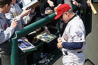 Lehigh Valley Ironpigs manager Ryne Sandberg #23 signs autographs during the first game of a double header against the Rochester Red Wings at Frontier Field on April 14, 2011 in Rochester, New York.  Rochester defeated Lehigh Valley with a walk off home run 3-1 in the bottom of the seventh.  Photo By Mike Janes/Four Seam Images