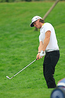 Kristoffer Broberg (SWE) chips onto the 3rd green during Thursday's Round 1 of the 2014 BMW Masters held at Lake Malaren, Shanghai, China 30th October 2014.<br /> Picture: Eoin Clarke www.golffile.ie