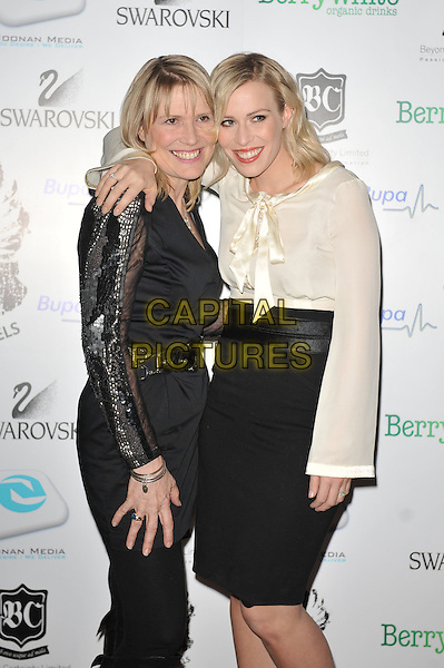 Holly and Natasha Bedingfield.'Global Angels Awards', The Park Plaza Hotel, Westminster, London, England. 2nd December 2011..half length white cream top bow long sleeve black skirt family sisters siblings .CAP/MAR.© Martin Harris/Capital Pictures.