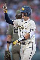 Michigan Wolverines catcher Joe Donovan (0) on first base after a single against the Vanderbilt Commodores during Game 1 of the NCAA College World Series Finals on June 24, 2019 at TD Ameritrade Park in Omaha, Nebraska. Michigan defeated Vanderbilt 7-4. (Andrew Woolley/Four Seam Images)