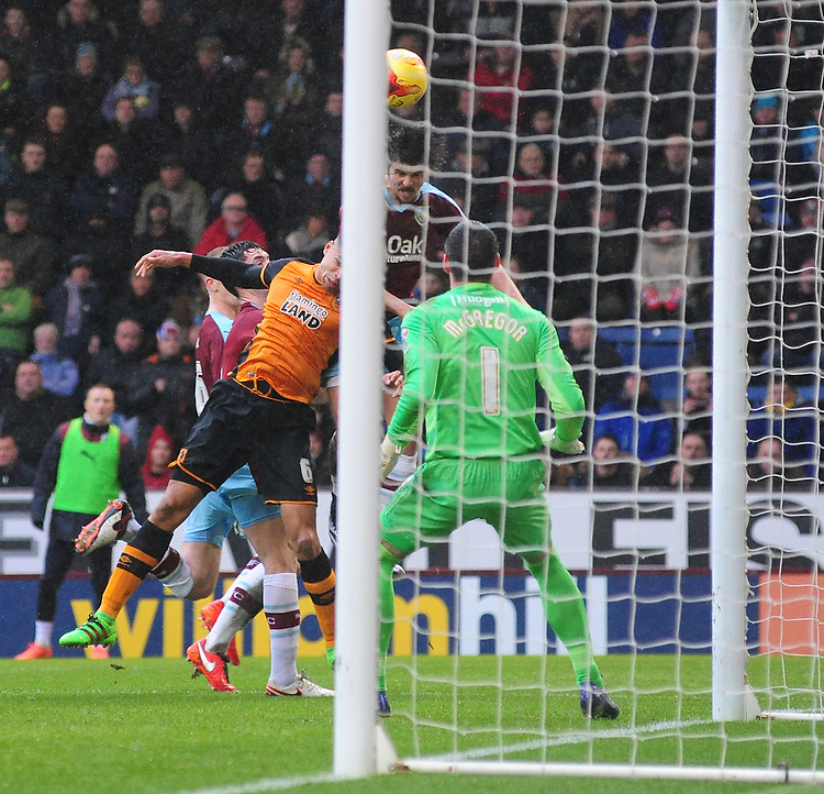 Burnley&rsquo;s Joey Barton heads the ball over the bar under pressure from Hull City's Curtis Davies<br /> <br /> Photographer Chris Vaughan/CameraSport<br /> <br /> Football - The Football League Sky Bet Championship - Burnley v Hull City - Saturday 6th February 2016 - Turf Moor - Burnley <br /> <br /> &copy; CameraSport - 43 Linden Ave. Countesthorpe. Leicester. England. LE8 5PG - Tel: +44 (0) 116 277 4147 - admin@camerasport.com - www.camerasport.com