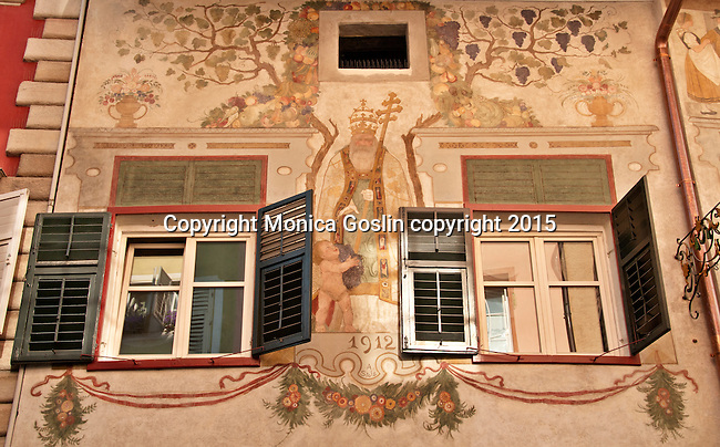 Frescos decorating the entire facade of a building in the historical downtown in Bolzano, Italy