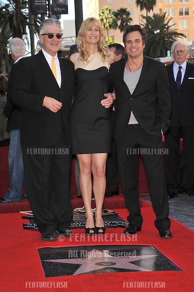 Laura Dern with Mark Ruffalo (right) & David Lynch on Hollywood Boulevard where, together with her parents Bruce Dern & Diane Ladd, she was honored with a star on the Hollywood Walk of Fame. This was the first time in history that three stars from the same Hollywood family dynasty of actors was honored at the same time..The Hollywood Walk of Fame is celebrating its 50th anniversary this month..November 1, 2010  Los Angeles, CA.Picture: Paul Smith / Featureflash
