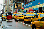 cabs backed up in new york city traffic with pedicab