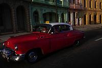 HAVANA, CUBA - JUNE 17: A Cuban taxi drives a passenger along the Malecon, Havanas waterfront, in Old Havana, on 17th June, 2015 in Havana, Cuba. <br /> Daniel Berehulak for Panasonic/Lumix