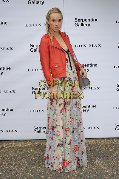 Suki Waterhouse.Serpentine Galley Summer Party, Kensington Palace Gardens, London, England..26th June 2012.full length white dress floral print red leather jacket bag purse grey gray .CAP/PL .©Phil Loftus/Capital Pictures.
