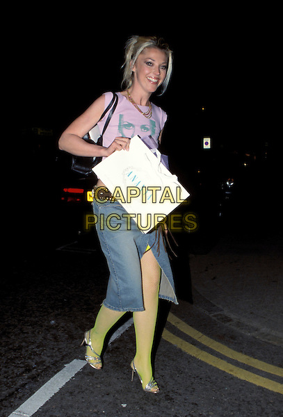 TAMARA BECKWITH.Ref:11567AH.silver sandles, green tights, denim skirt, jean skirt full length.sales@capitalpictures.com.www.capitalpictures.com.©Capital Pictures.