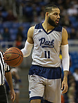 Nevada's Cody Martin (11) brings the ball up the court against South Dakota State in the first half of an NCAA college basketball game in Reno, Nev., Saturday, Dec. 15, 2018. (AP Photo/Tom R. Smedes)