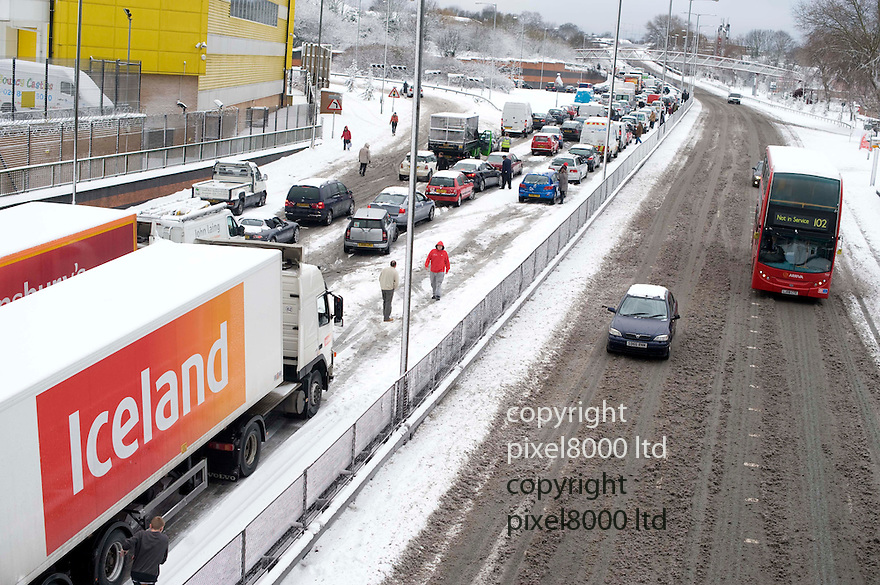 North London blizzard causes chaos on the North Circular near Brent Cross. Iceland lorry.man cross central reservation to petrol station run out of petrol walks down the North ciurcular .pic by Gavin Rodgers/ Pixel 8000.07917221968
