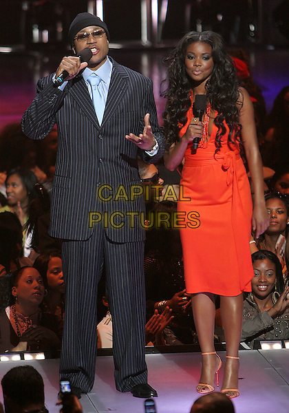 "LL COOL J & GABRIELLE UNION.BET's ""Rip the Runway"" Fashion Show, New York, NY, USA..March 1st, 2006.Photo: Jackson Lee/Admedia/Capital Pictures.Ref: JL/ADM.full length host hosts red dress black pinstripe suit.www.capitalpictures.com.sales@capitalpictures.com.© Capital Pictures."