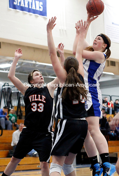 Burlington, CT-11 December 2012-121112CM10- Lewis Mills' Teagan Dunn shoots over Terrvyille's Katie Duncan (33) and Olivia Pilarski, right, Tuesday night in Burlington.  Mills won 59-35. Christopher Massa Republican-American