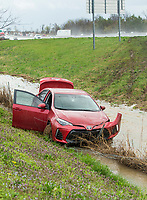 A Toyota Corolla sits in the ditch Thursday, March 19, 2020 next to Northbound Interstate 49 past Exit 81 in Rogers. Logan Mason, a University of Arkansas student from Bentonville, said he was driving the car Northbound when he came into heavy rain and hydroplaned. Mason said he was not injured. A second wreck happened at the same time on the Southbound side of the freeway, which caused lane closures. The National Weather Service issued a flash flood warning and tornado watch Thursday for Northwest Arkansas. Check out nwaonline.com/200320Daily/ for today's photo gallery.<br /> (NWA Democrat-Gazette/Ben Goff)