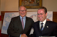 August 12,  2003, Montreal, Quebec, Canada<br /> <br /> Gerald Tremblay, Mayor of Montreal (L) shake hands with <br /> Claude Bechard, Quebec Minister of Work, Social Solidarity and Family (Emploi, Solidarit&Egrave; Sociale et famille) (R)<br /> after an announcement about fighting poverty on the Montreal island, during a  press conference, august 12,  2003  in Montreal, CANADA<br /> <br /> <br /> Mandatory Credit: Photo by Pierre Roussel- Images Distribution. (&copy;) Copyright 2003 by Pierre Roussel