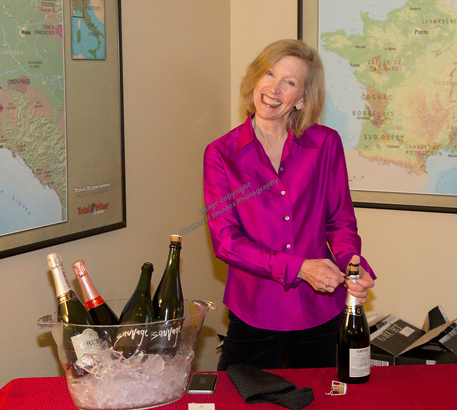 """Deborah Green opens bottles of sparkling wine before the Reno Magazine """"Bubbles Tasting"""" event at Total Wine in Reno on Friday night, February 9, 2018."""