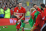 UEFA EURO 2016 Qualifier match between Wales and Andorra at Cardiff City Stadium in Cardiff : Wales player Gareth Bale sharing a joke with team mate Jonathan Williams after the game.