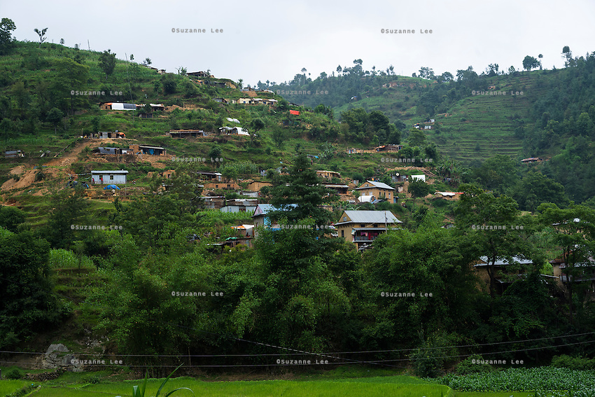 The SOS Children's Villages Child Care Space sits on top of a hill (extreme left) in Rayale, Nepal on 1 July 2015. The roads to Rayale have just been cleared again after multiple landslides cut it off. The monsoon is causing mudslides and aftershocks still occasionally happen. The April 25th earthquake together with big aftershocks on April 26 and May 12 killed over 8000 people and injured over 19000 people, destroying over half a million houses. Photo by Suzanne Lee for SOS Children's Villages