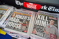 "New York daily newspapers, seen on Sunday, July 22, 2012, report on the mass shooting during the screening of ""The Dark Knight Rises"" in a theater in Aurora, Colorado, allegedly by 24 year old James Holmes. Twelve people were killed and 58 injured. (© Richard B. Levine)"