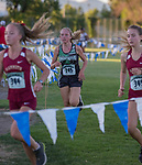 High school runners compete in the Bonanza Casino Nevada Twilight Classic at Mira Loma Park in Reno on Friday night, August 30, 2019.